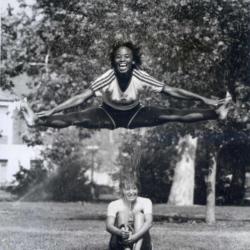 A member of the cheer team performing a jump splintz