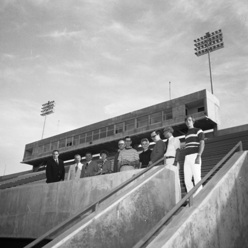 People standing in front of the new Press Box