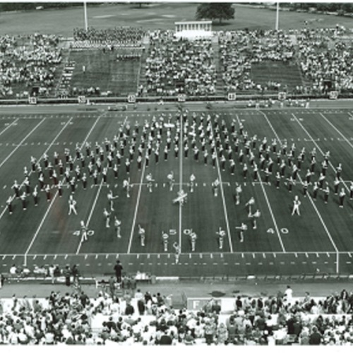 Marching band in formation on football field, no date