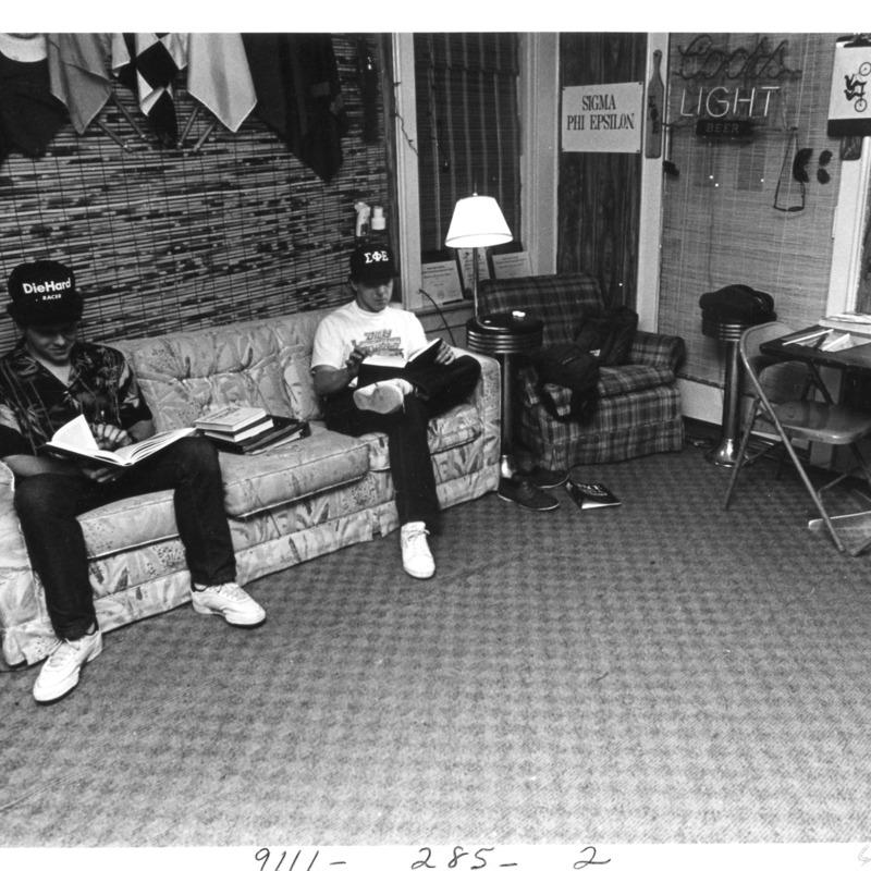 Sigma Phi Epsilon members studying in dorm