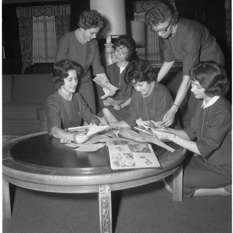 Chi Omega members working on a scrapbook, 1962