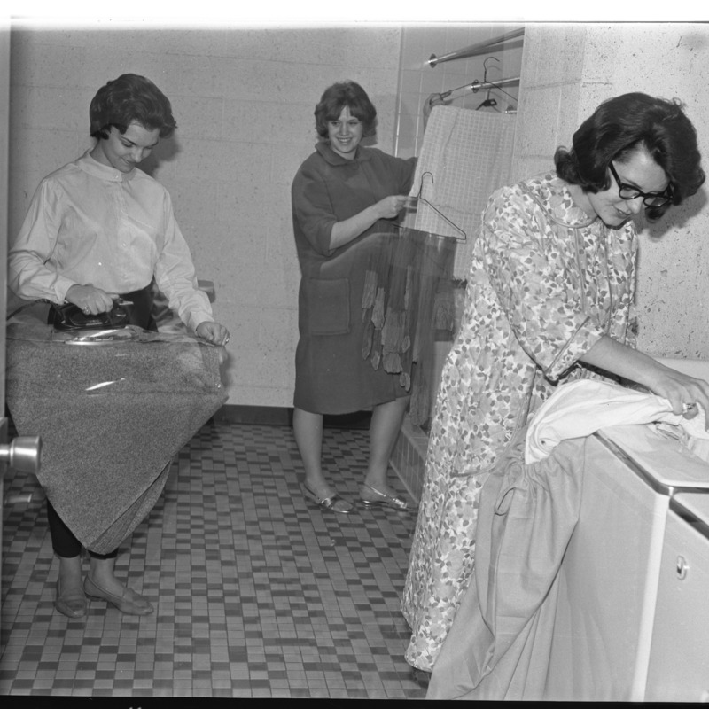 Students doing ironing in Erickson laundry room
