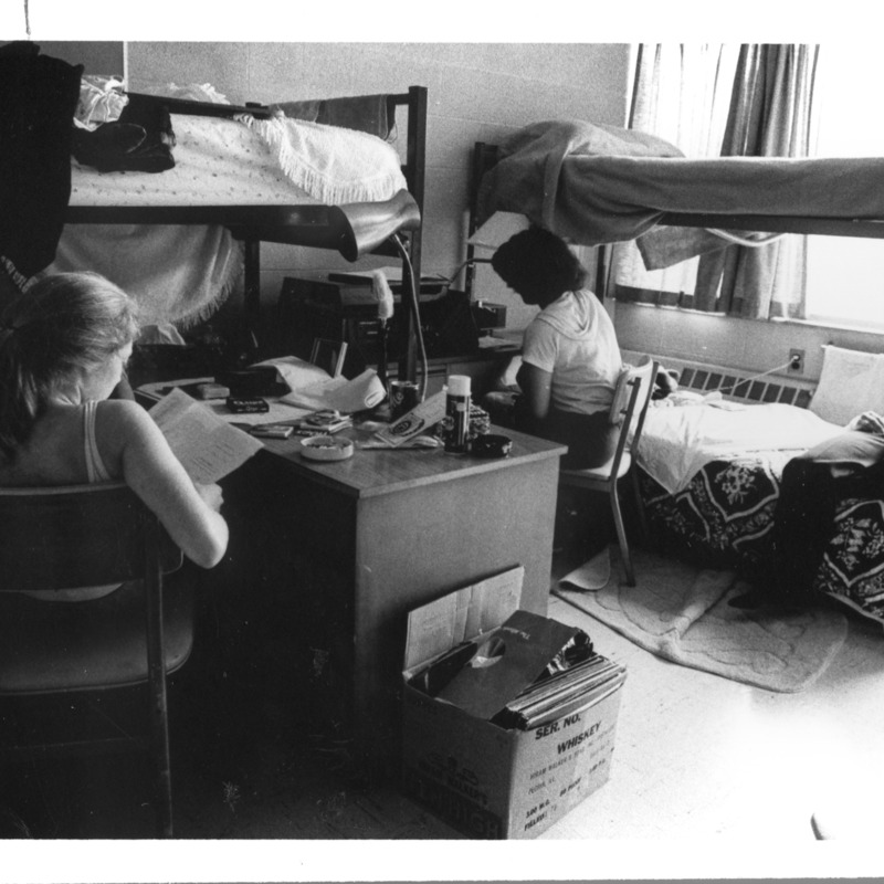 Students studying in a crowded dorm room